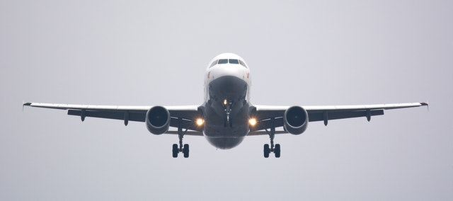 A picture of a plan to denote Air Canada's free covid-19 travel insurance that is available for international travel.