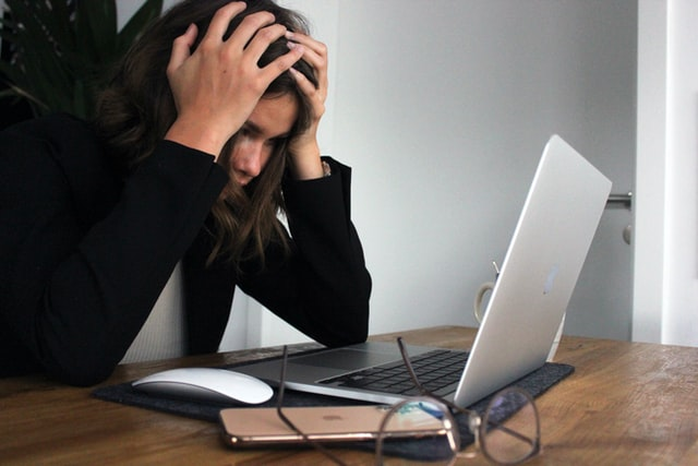 A picture of person stressed to denote a person who was denied EI benefits and doesn't know what to do next.