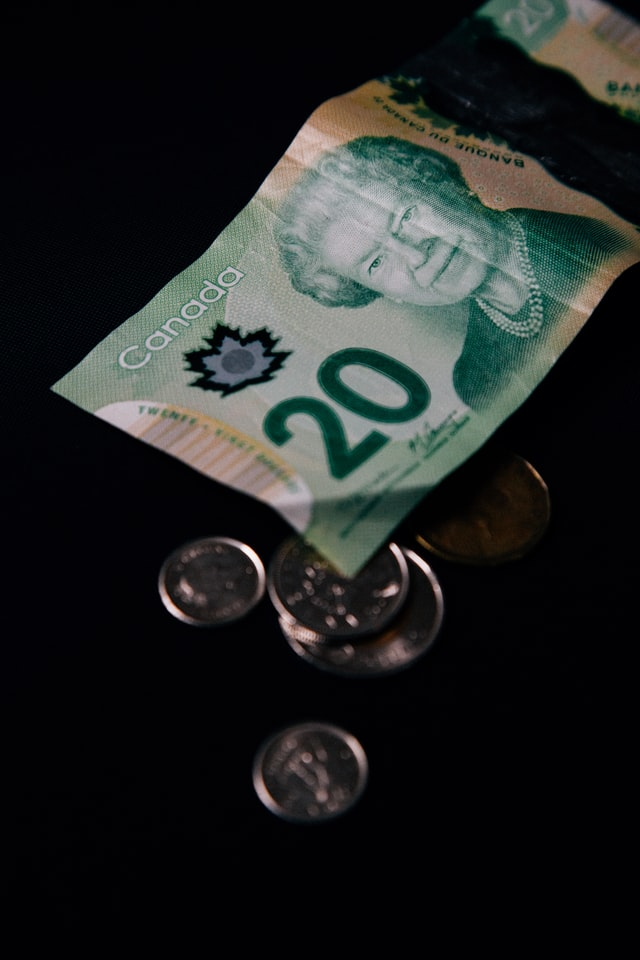 Picture of Canadian money to highlight paying taxes and highlight subject of Canada Recovery Benefits unavailable if you have not filed your 2019 and 2020 taxes.